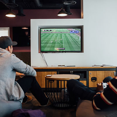 Guys playing x box in social space