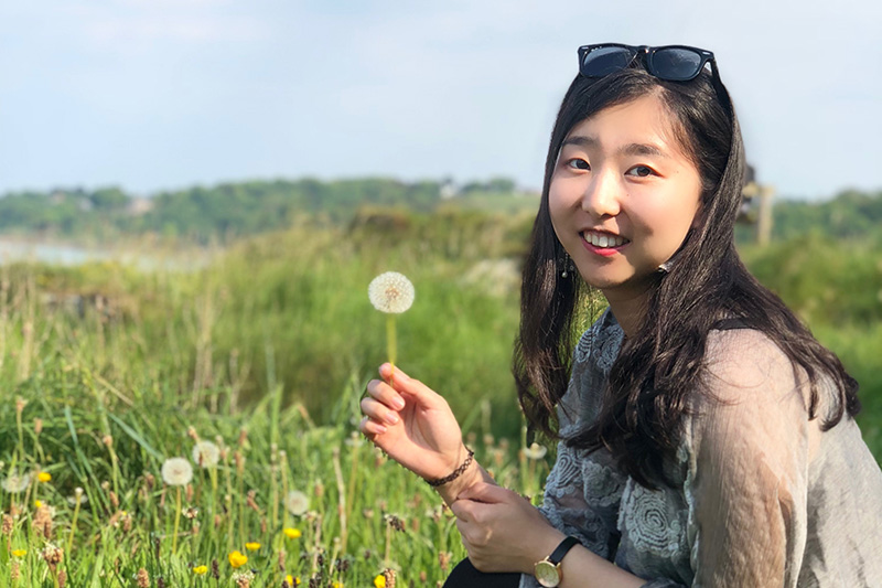 Yuan in Bangor with a dandelion clock