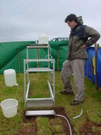 Dr Jamie Blennerhassett of New Zealand with the innovative rainfall simulator he brought to the Department of Agricultural and Environmental Science at Queen's University to measure phosphorus soil losses with different fertilisers.