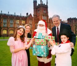Santa Claus, represented by Queen's University Head Porter Chris Shannon, arrived with two special helpers and several empty sacks to launch the annual porters' Christmas toy appeal to staff and students. Helping to fill Santa's first sack was Pro-Vice-Chancellor for Community and Communications Professor Gerry McCormac and also supporting the appeal was Marion Smyth, N I Hospice Community Fundraiser.