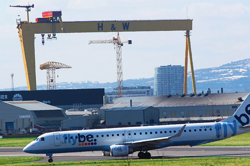 Flybe plane touching down at George Best Airport in Belfast