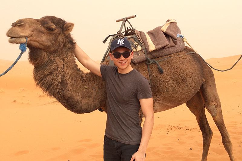 Rory Cao with a camel