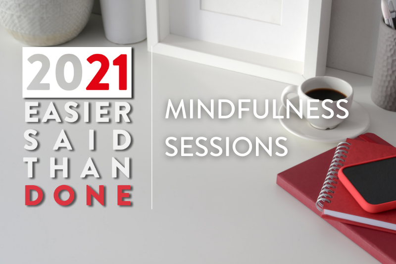 A red notebook and coffee cup sits on top of a table. Text reads: 2021: Easier Said Than Done. Mindfulness Sessions.