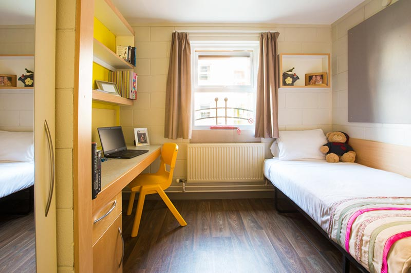 Room in Elm's Village with yellow chair