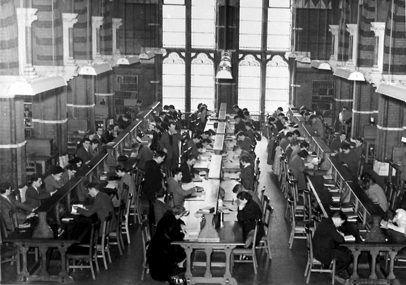 Overhead view of inside the old Queen's library with many students studying