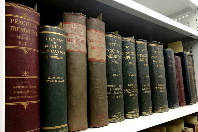 A shelf of books from the Belfast Medical Library in the Special Collections store.