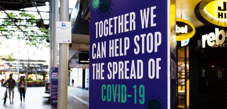 Covid banner saying we can stop the spread