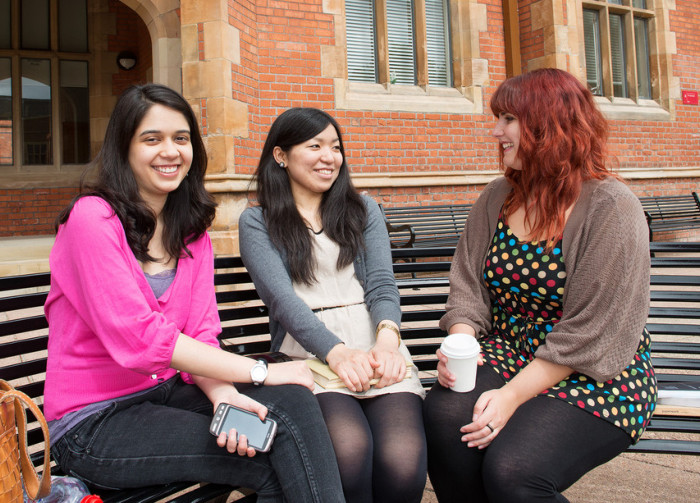 International students on bench in Quad