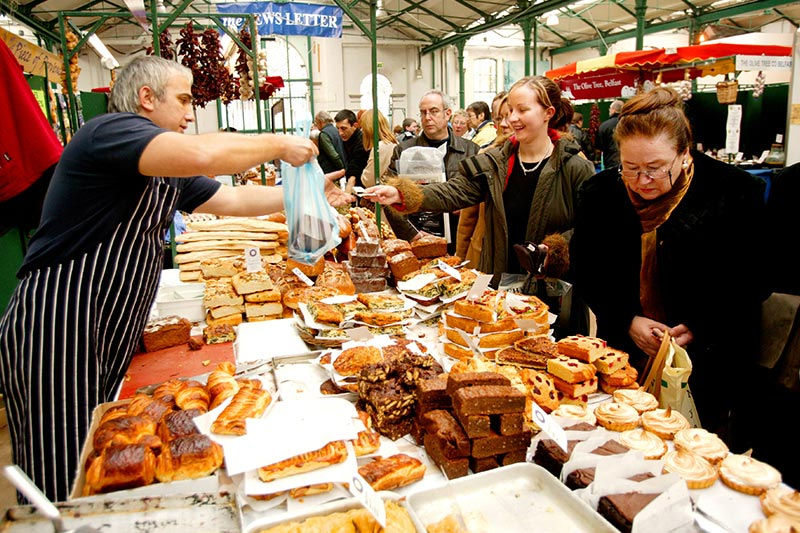 Customers shopping at Saint Georges Market