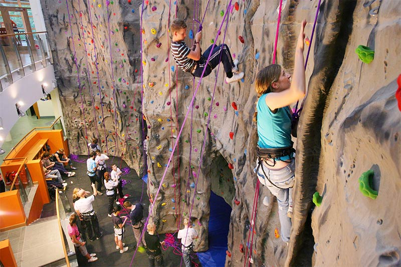 members of the Queen's University Belfast Mountaineering club using the climbing wall in the PEC