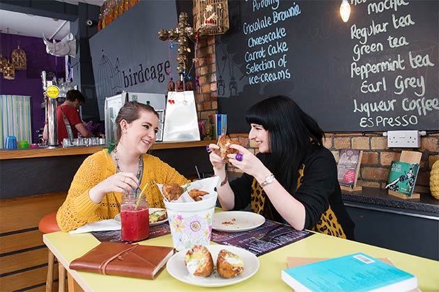 two female students enjoying lunch together in a casual restaurant