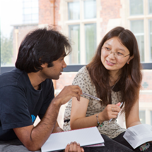 two international students discussing their lecture notes