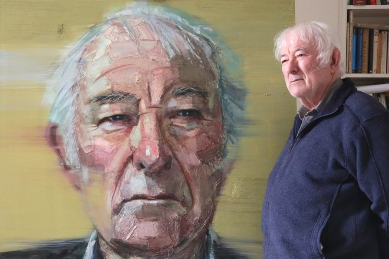 Seamus Heaney with his portrait