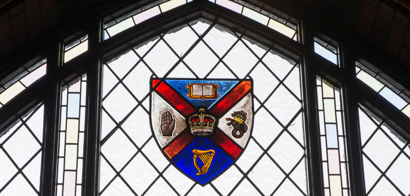Graduate School window with crest