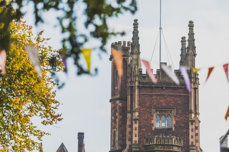 Main tower of the Lanyon building with multi coloured bunting in the foreground
