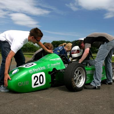 Students working on formula student car