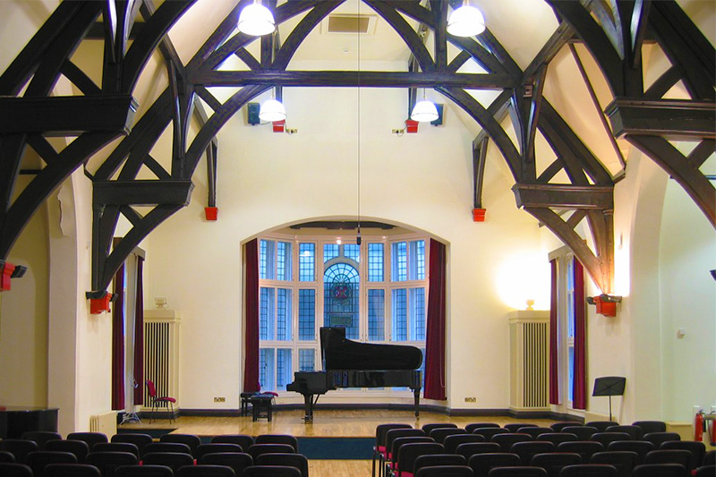The Harty room with a piano on stage