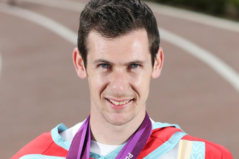 Paralympic, World and European gold medal-winning Irish Paralympic athlete, Michael McKillopp, attending his honorary graduation