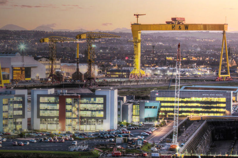 Iconic image of the institute next to Harland and Wolff cranes in Belfast