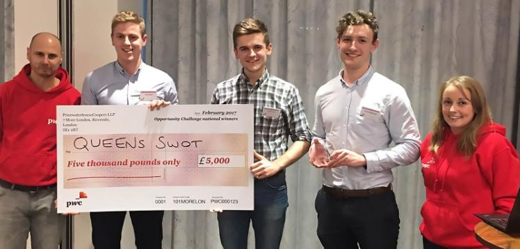 Queen's Students Working Overseas Trust (SWOT)team collecting their award and prize money for winning the Opportunity Challenge