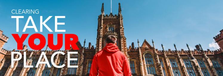 student in red hoodie looking up at the Lanyon building