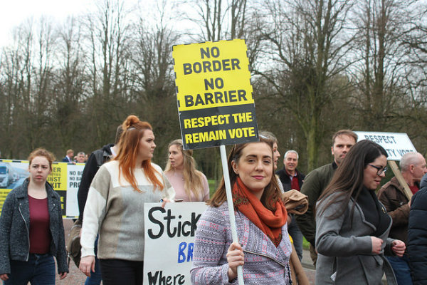 Protestors wielding placards against a hard border in Ireland