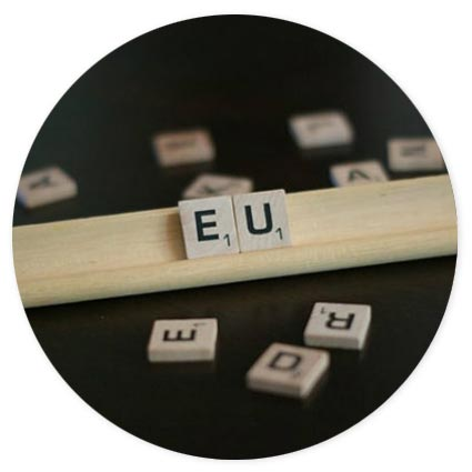 Scrabble tiles spelling out EU