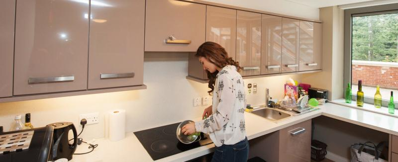 a student cooking in the kitchen of a Willow walk student accommodation