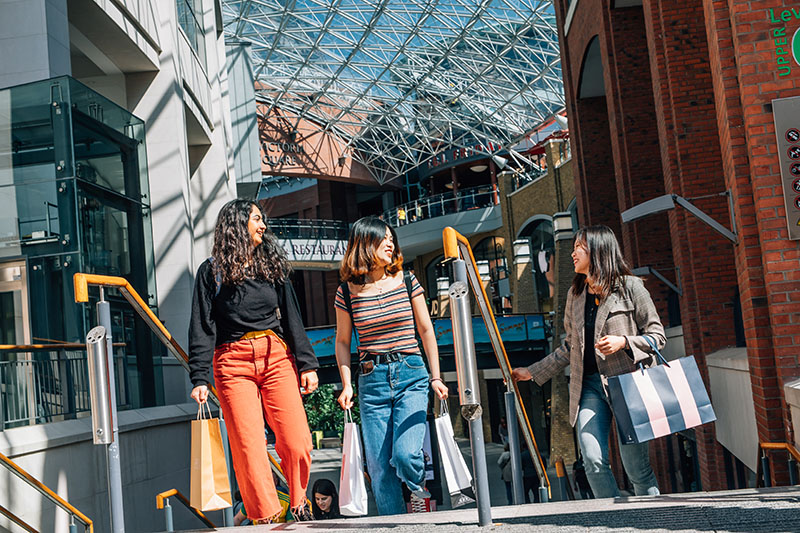 3 female students shopping in Victoria Square