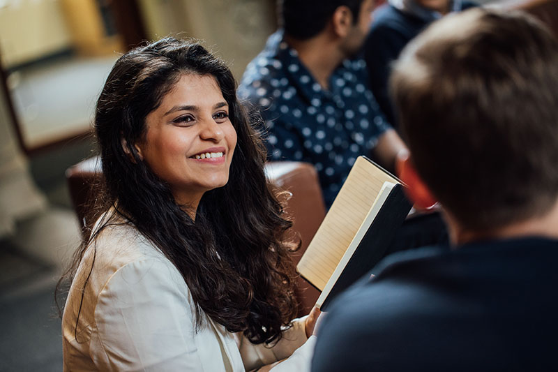 Female student smiling with book