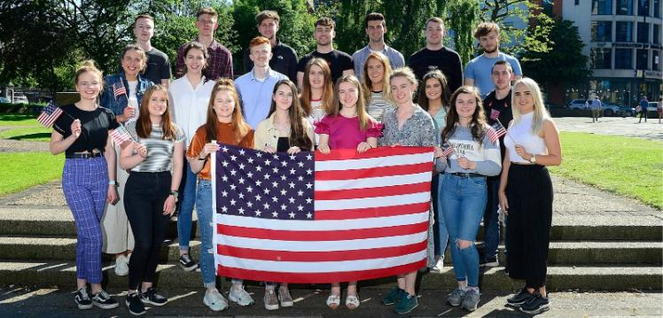 Students holding an American flag