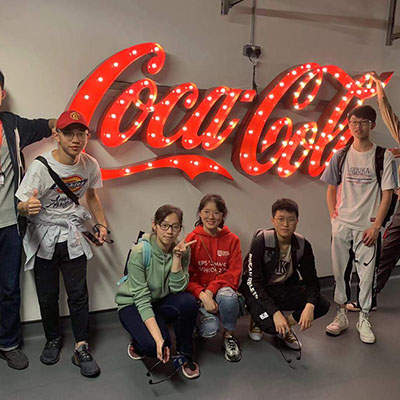 Students with Coca-Cola sign