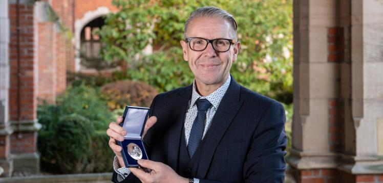 David Jones with Griffith medal and prize