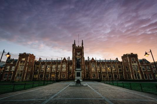 Wide shot of Queen's at dusk