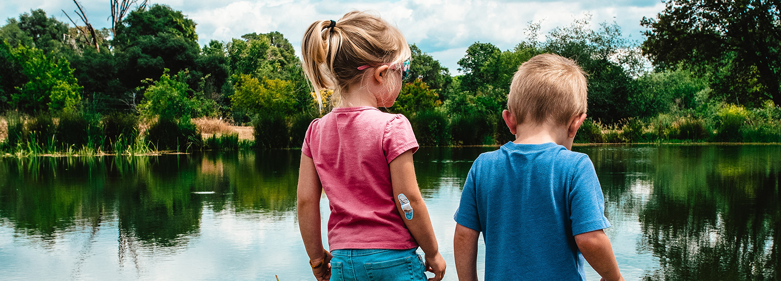 2 children near a lake