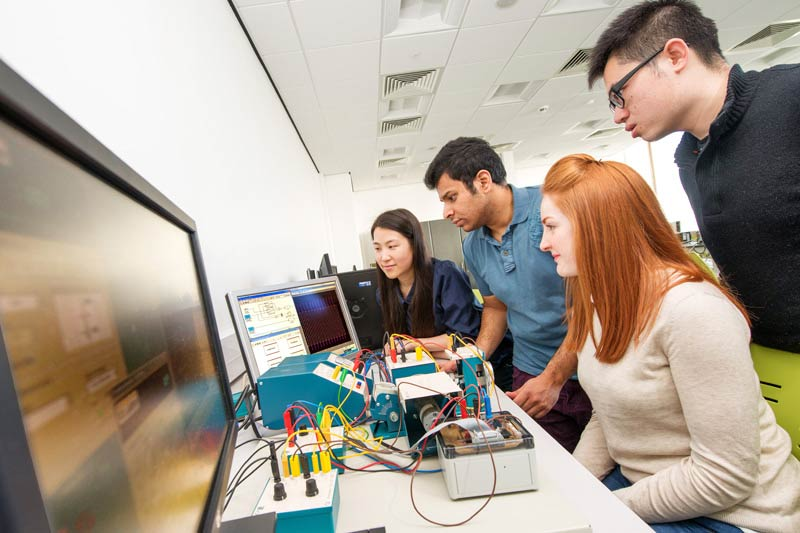 group of students carrying out electronic engineering research together