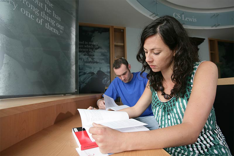 2 students reading notes in the C.S. Lewis reading room
