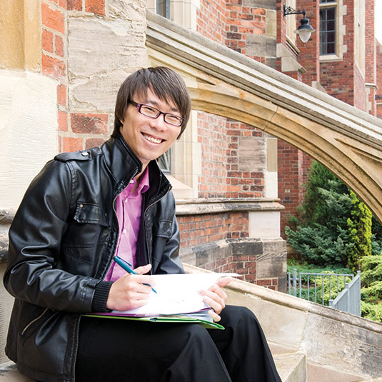 male student sitting on steps