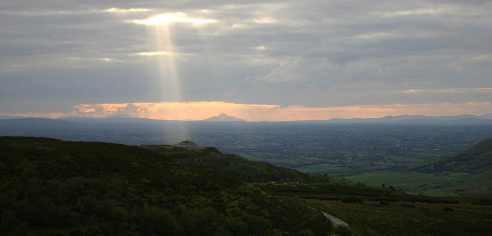 QUB-GAP-Banner-Sunbeam-on-Carrowkeel-passage-tomb-Croagh-Patrick-in-distance