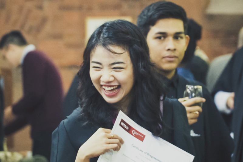 international female student laughing at student welcome event