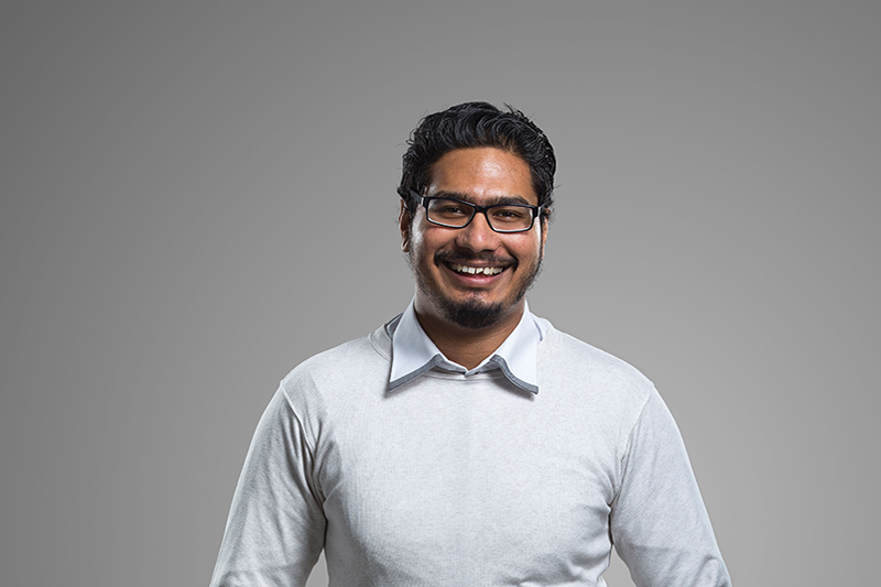 informal studio photograph of smiling male international student