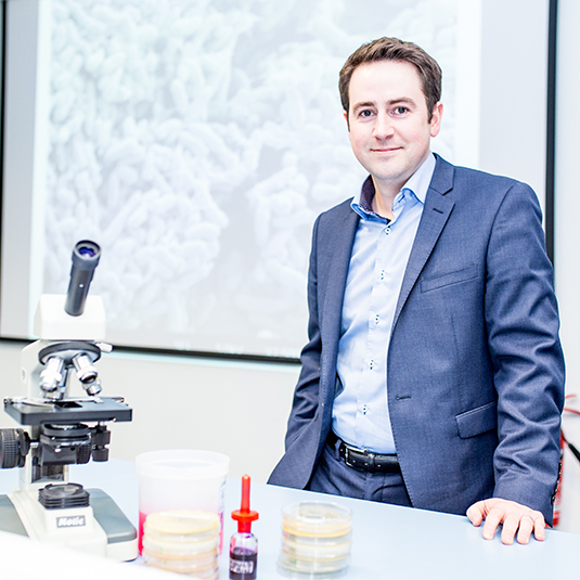 Image of Professor Brendan Gilmore at a microscope