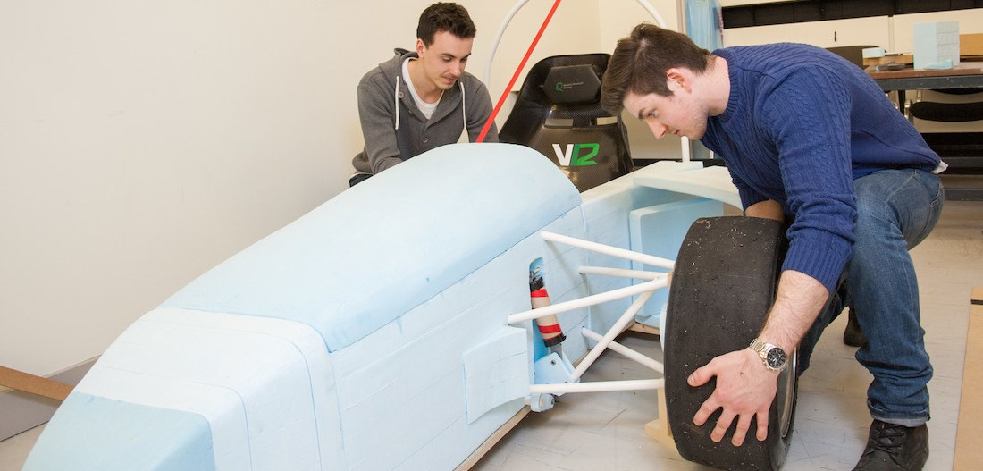 Students with formula car prototype