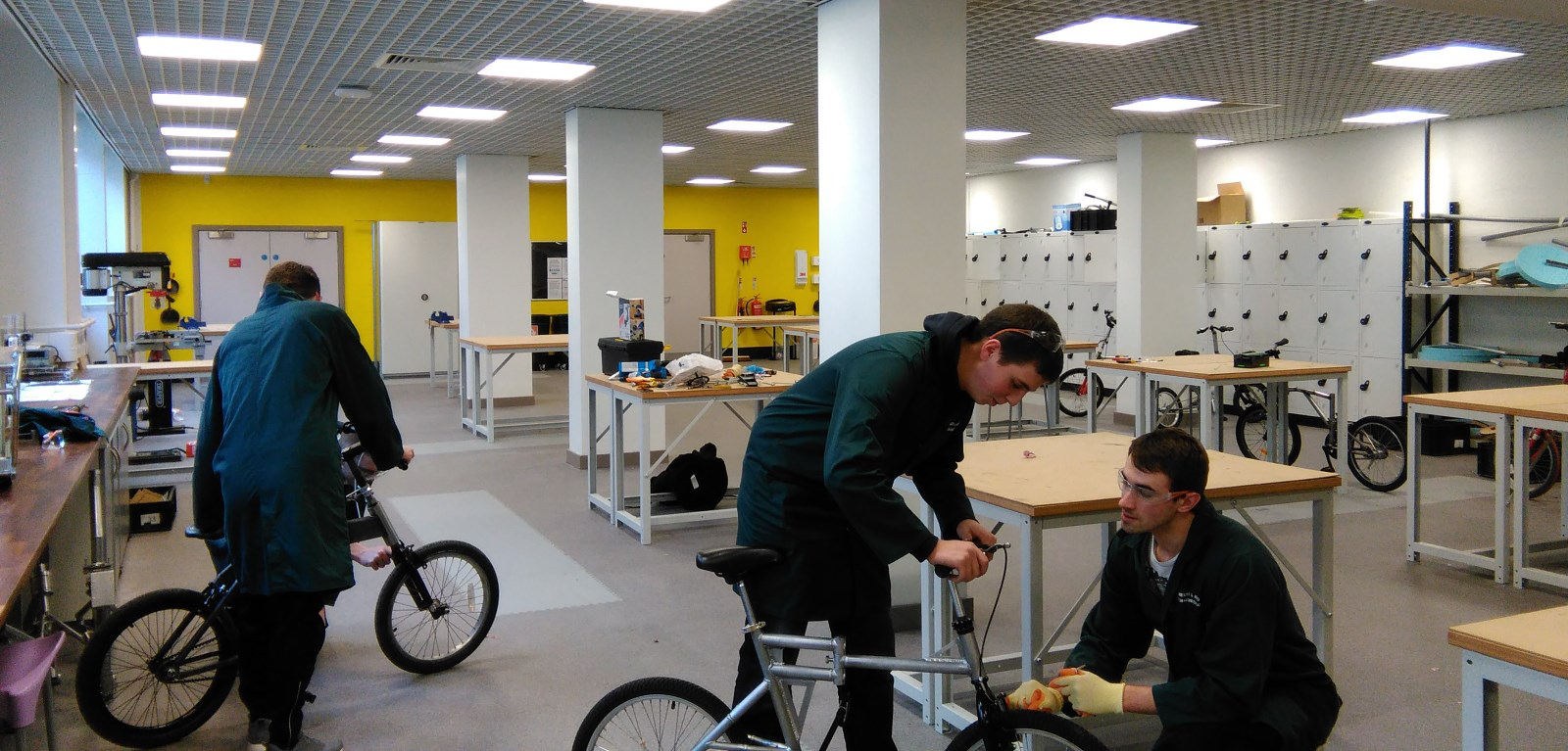 Students building folding bicycles