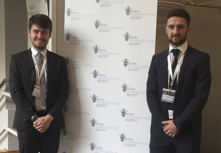 Image of Scott Davidson and John Gillen, former MPharm students, presenting research at the Royal Pharmaceutical Society Conference