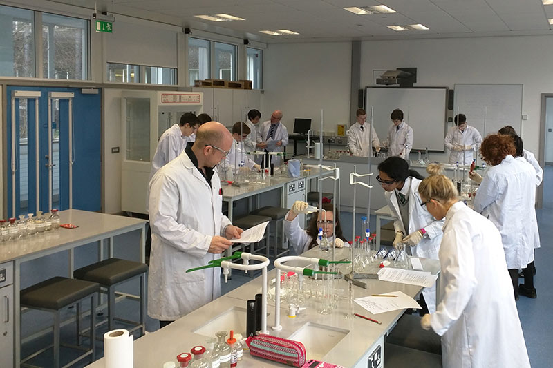 Students and staff working in a chemistry laboratory