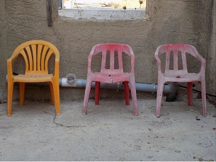 Three Plastic Chairs in Kos