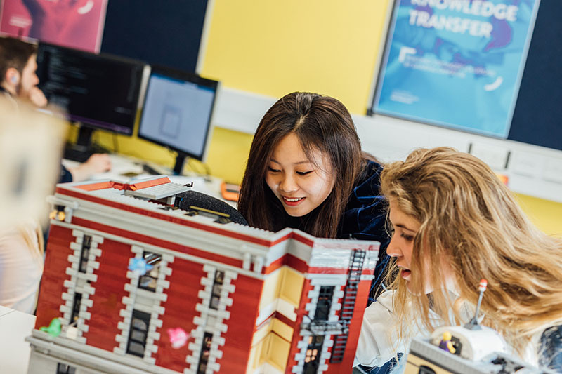 Students learning in the Lego Room in the Computer Science Building