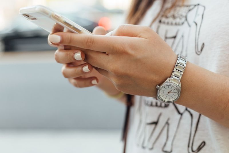 A woman's hands on a mobile phone