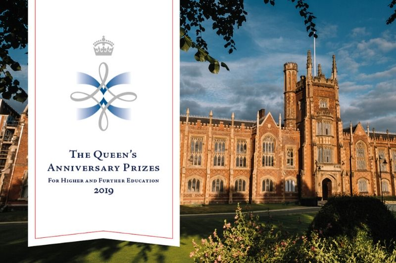 Queen's anniversary prize logo over the op of the Lanyon building